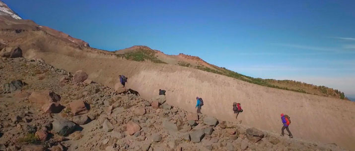 Widescreen sample - students climbing ridge